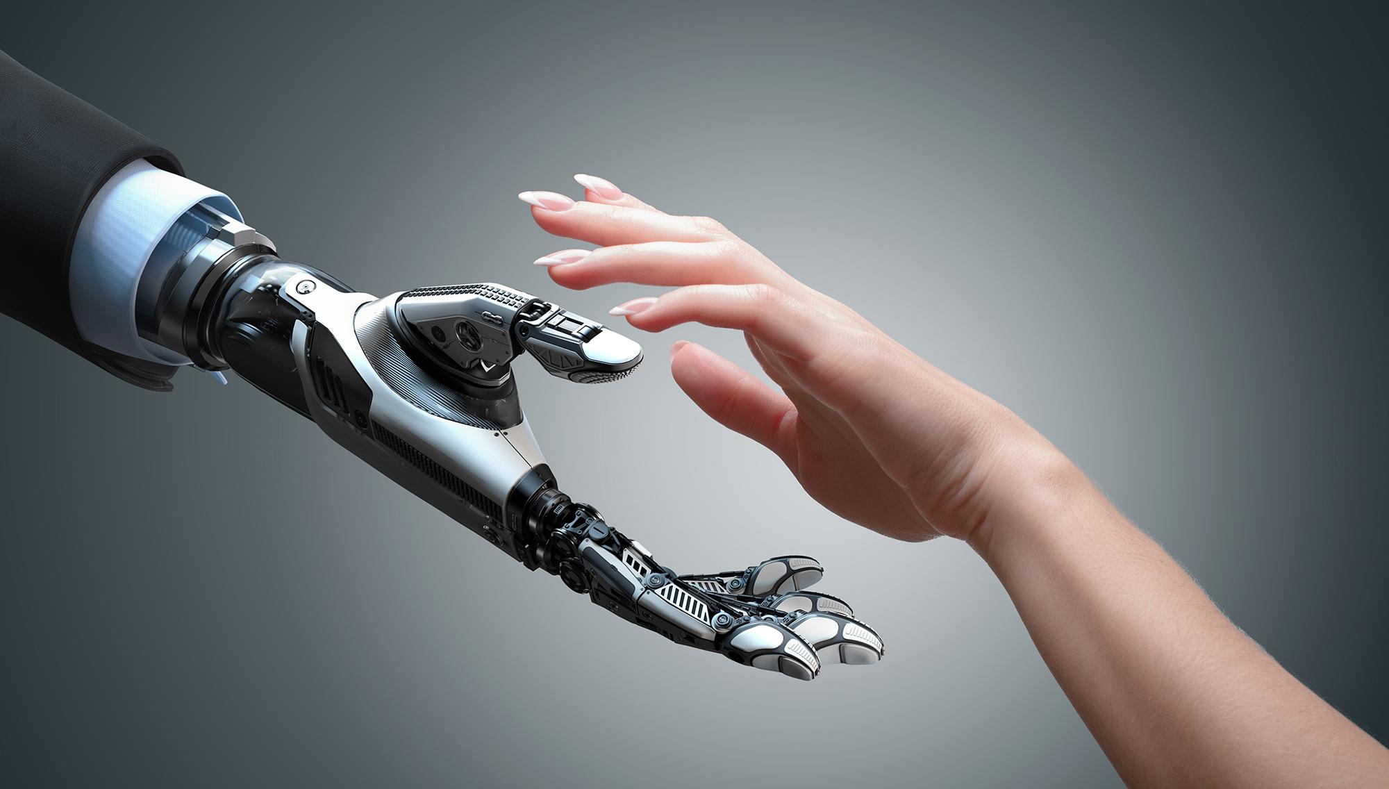 uma mão robótica se encontrando com uma mão humana preste a se tocarem